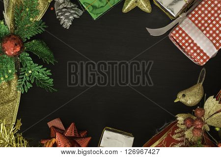 Top view Gift boxes and decorations on festival days placed on a black background. Space for your text. For Christmas New Year and Valentine's Day concept.