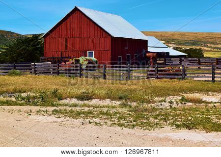 Rustic wooden barn surrounded by wooden fences taken at a ranch on Santa Rosa Island, CA