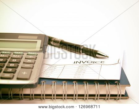 Invoice With Calculator And Pen On Desk ( vintage Image)
