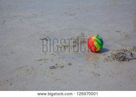 colorful toys for childrens sandboxes against the sea