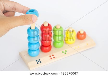 Playing colorful backgammon wooden toy stock photo