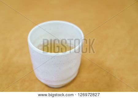 Cup of japanese tea on wooden table