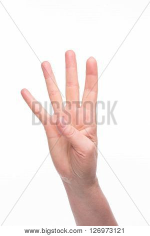 Four fingers of old woman's hand over white background. Lady showing four ways out over white background.