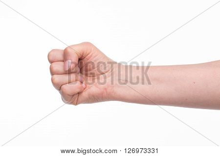 Old woman's fist with perfect manicure over white background. Nice fist of old lady in studio.