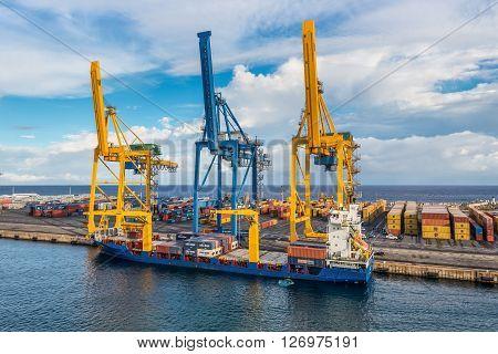 Le Port Reunion island France - December 24 2015: General Cargo Ship Kiara at the Harbor of Le Port on Reunion island France. Containers are unloaded from the ship.