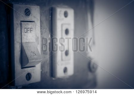 This is a photo of an age-old switch board that represents the theme of being powered once the switch is on.