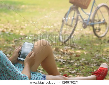 woman using mobile smart phone at the park Business technology internet and networking concept