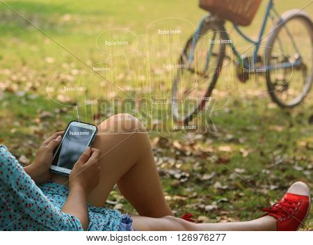woman using mobile smart phone at the park touch screen passive income Business technology internet and networking concept
