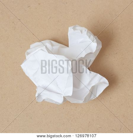 Crumpled white paper ball on wood background