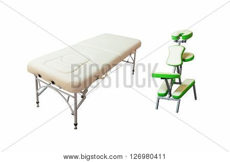 Massage bed and chair isolated on white background