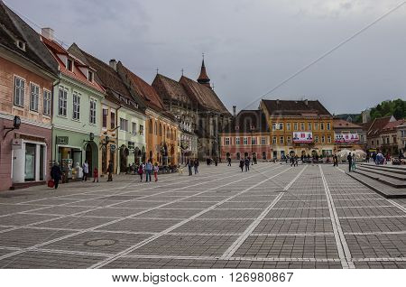 Brasov, Transylvania, Romania- April 29, 2015: Brasov Council Square is historical center of city with Black Church on background.
