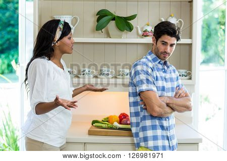Young couple into an argument in the kitchen