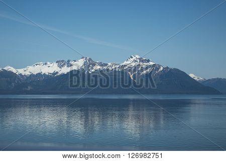 Snowy mountains reflect in Alaska's Glacier Bay