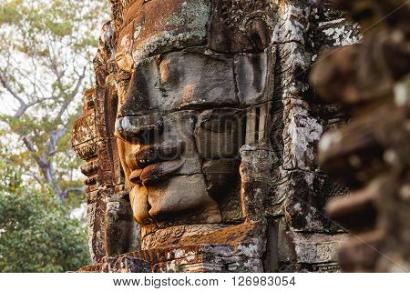 Towers with faces in Angkor Wat a temple complex in Cambodia and the largest religious monument in the world. UNESCO World Heritage Site.