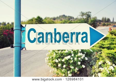 Canberra, Australia Road Sign with beautiful nature and road on background