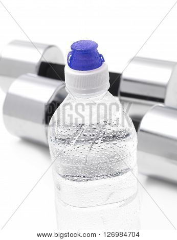 Gym Dumbells with a water bottle isolated on a white background
