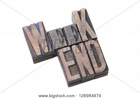 tilted weekend word made from vintage wooden letterpress type isolated on white