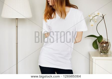 Close Up Of Young Female Wearing White T-shirt With Blank Space For Your Text Message, Looking Away