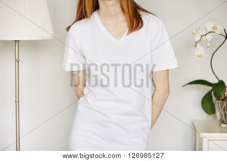 Cropped Portrait Of Redhead Teenage Girl In Blank White T-shirt For Your Text Message Or Advertising