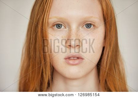 Close Up Isolated Portrait Of Caucasian Teenage Girl With Long Red Hair, Blues Eyes And Healthy Frec