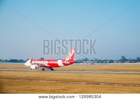 SATTAHIP, THAILAND - 21 DEC - Air Asia airline's passenger plane at U-Tapao airport with dried grass ground at Sattahip, Thailand on December 21, 2015
