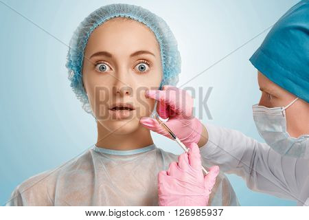 Close Up Isolated Shot Of Young Blonde Woman Patient Getting Injection With The Scared Expression On