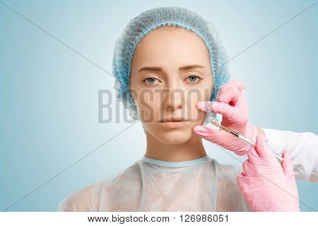 Close Up Of Young Caucasian Woman Getting Anti-aging Injections In Beauty Clinic. Headshot Of Female