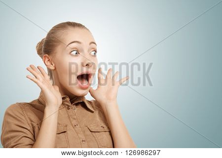 Isolated Headshot Of Young Surprised Caucasian Woman Looking In Excitement At The Blank Space For Yo