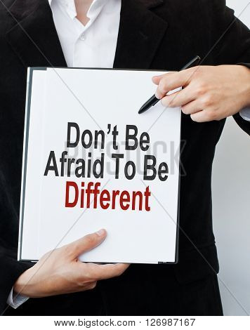 Don't Be Afraid To Be Different. Businessman showing message text