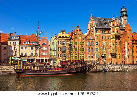 GDANSK, POLAND - APRIL 21, 2016: People at the quay port with many restaurants, view of Motlawa river in Gdansk. Old Town in Gdansk is a tourist attraction for visitors.