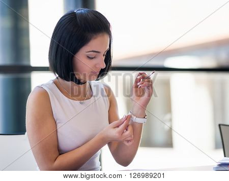 Woman adjusting at her watch