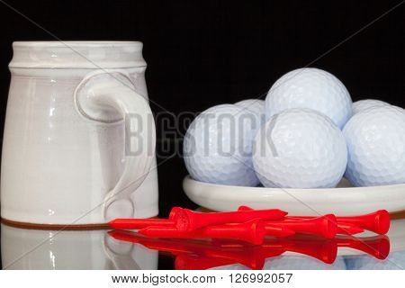 Cup of coffee a golf balls on the glass plate