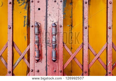 Selective focus of steel door handles of the old sliding door (door, handle, vintage)