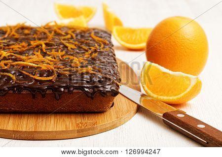 Closeup Chocolate And Orange Cake With Orange Peel