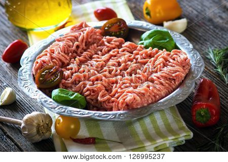 Fresh Raw Minced Meat In A Plate Close Up On A Rustic Wooden Table