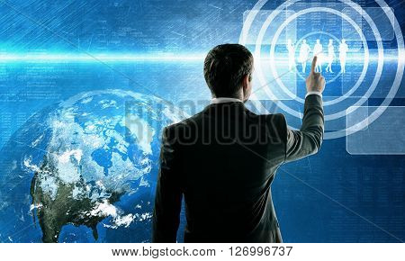 Business man pushing virtual team. Teamwork concept. Element of this image furnished by NASA