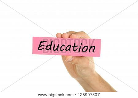 Hand holding a business card on a white background, education