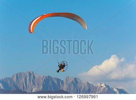 Flying with powered paraglider over Apuan Alps, Italy.