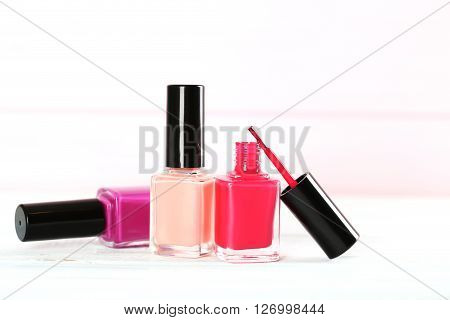 Bottles Of Nail Polish On A Wooden Table