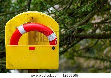 Photo of a life buoy on the beach