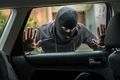 Car Thief Looking Through Car Window poster