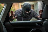 Car Thief Looking Through Car Window poster