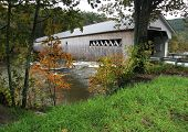 pic of covered bridge  - an historic lattice covered bridge in vermont during autumn - JPG