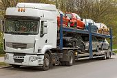 car carrier truck deliver new auto batch to dealer