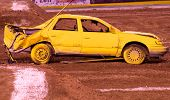 foto of monster-truck  - A yellow crashed car waiting to get ran over by a monster truck - JPG