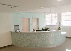 picture of medical office  - reception desk in a medical office with tile work on desk - JPG