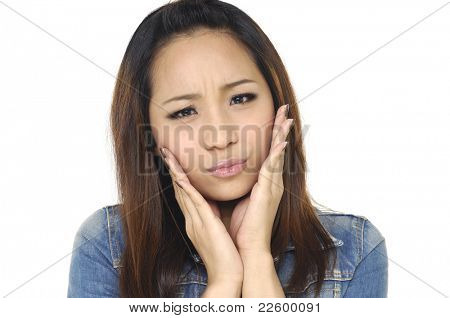 young woman worried isolated over white background. young