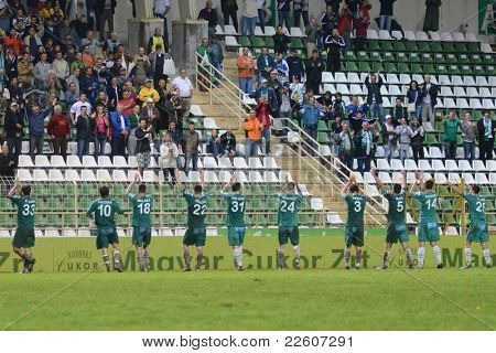 KAPOSVAR, HUNGARY - JULY 30: Kaposvar players celebrate after a Hungarian National Championship soccer game - Kaposvar (green) vs Videoton (white) on July 30, 2011 in Kaposvar, Hungary.
