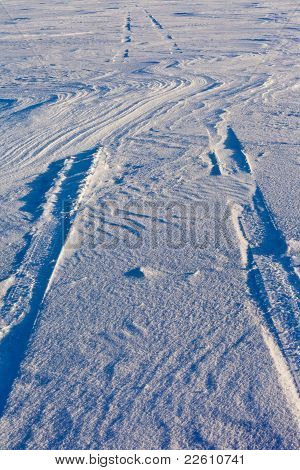 Snowdrift and tire tracks