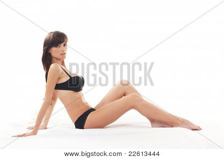 Young sexy woman in black lingerie over white background